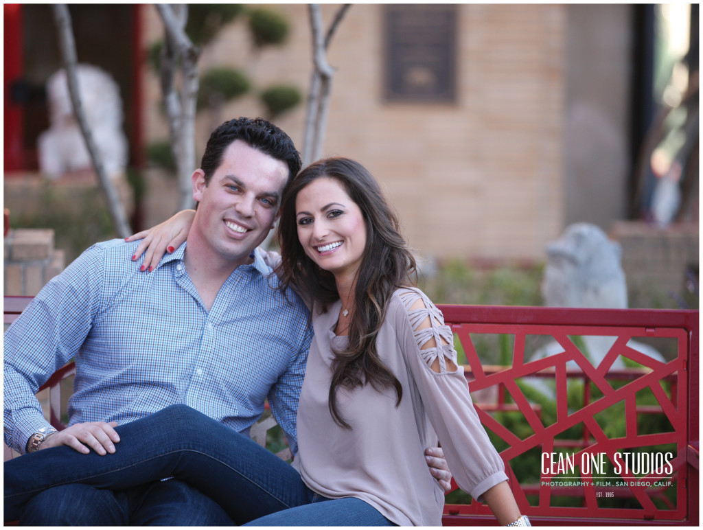 engaged couple on red bench   | Cean One Photography | Southern California Photographers | love story