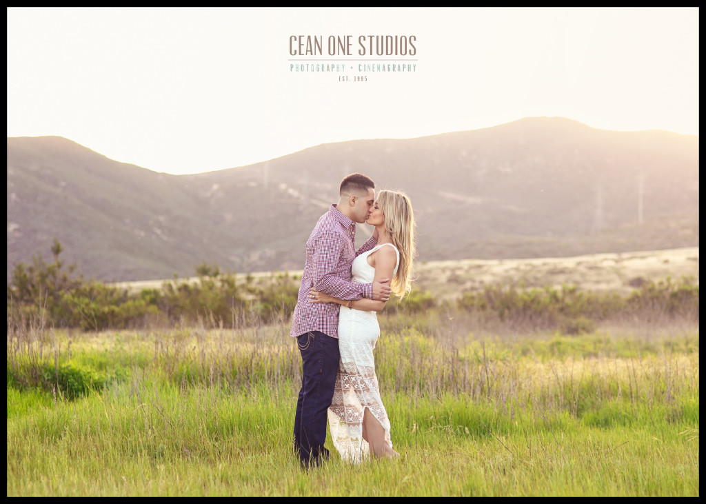 man and woman kissing in front of mountains | San Diego Engagement Photographer