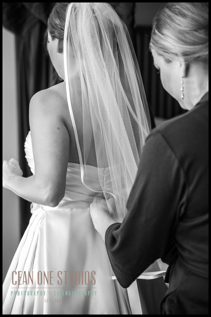 bride getting dressed | Hotel del Coronado San Diego Wedding Photographer