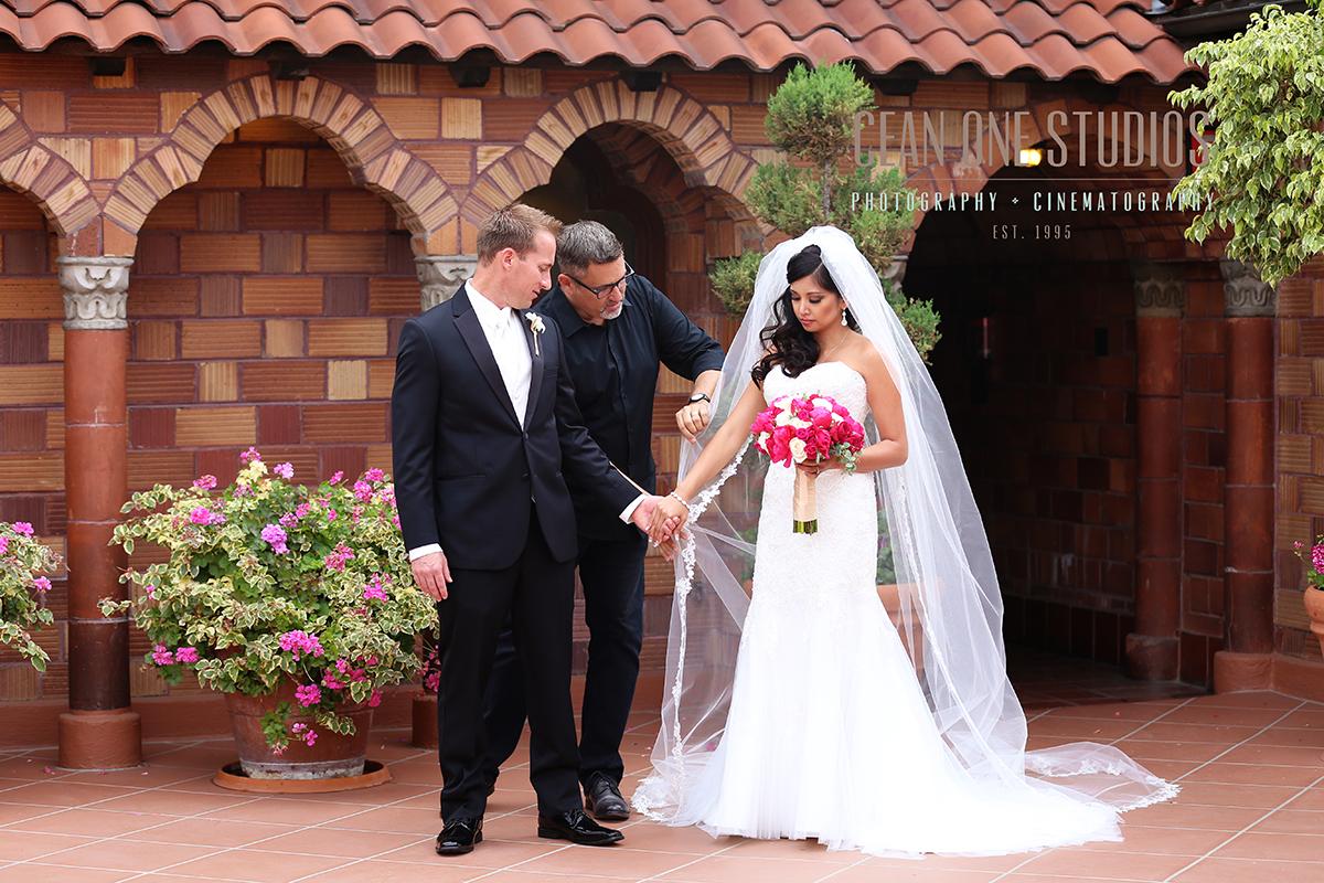 Photographer fixing brides veil | Cean One Photography | San Diego Wedding Photographer